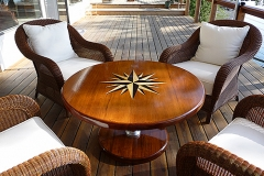 Compass Rose teak dining table for the deck