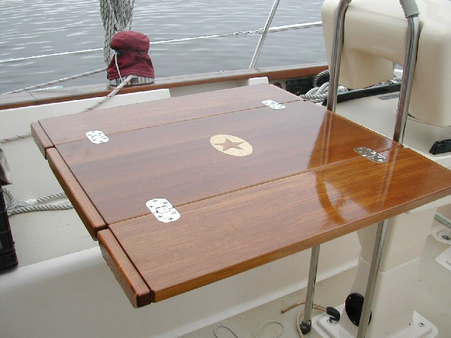 The beautiful inlay and hinges barely interrupt the smooth surface of this cockpit table.
