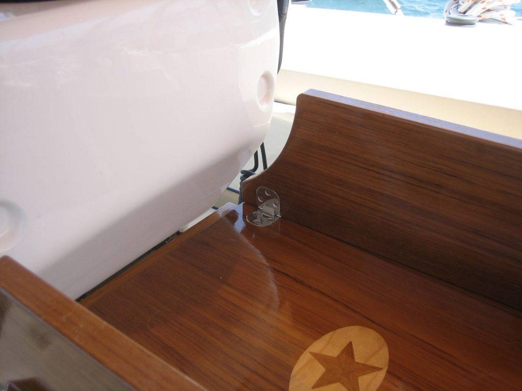 Partially folded teak cockpit table
