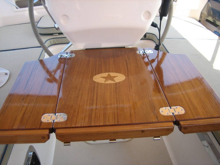 Unfolded teak sailboat cockpit table