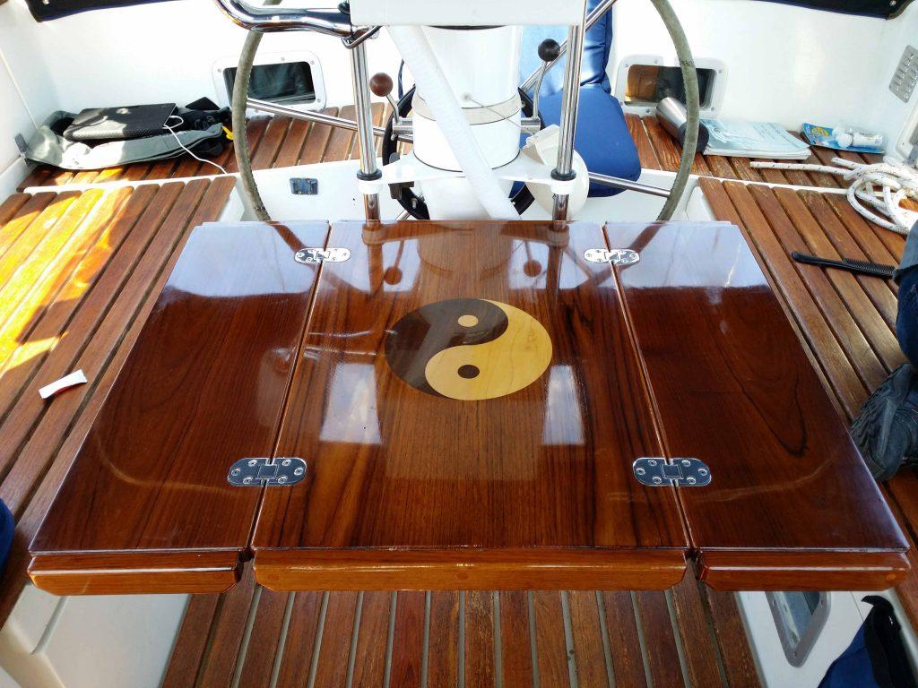 Teak cockpit table unfolded with teak inlay