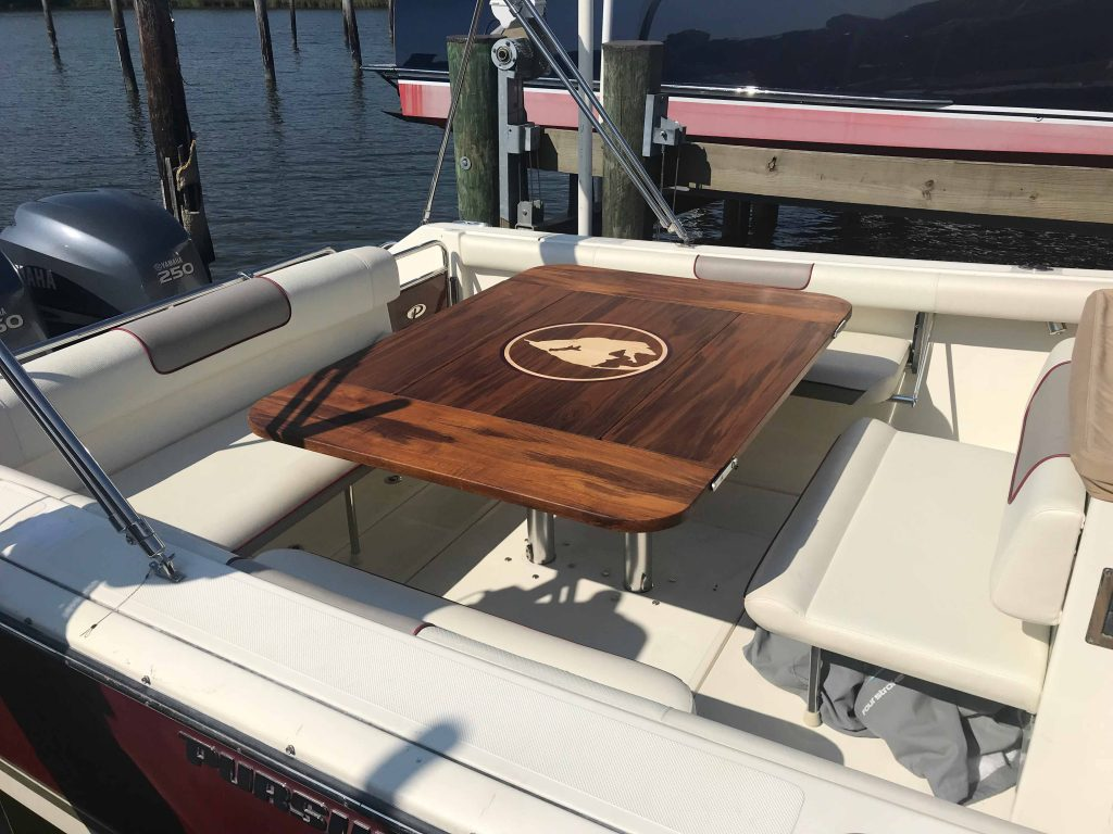 Yacht dining table with teak inlaid design