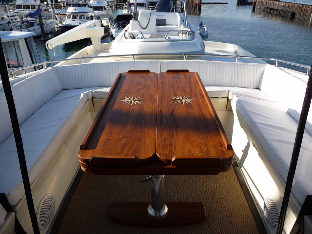Even when closed this yacht dining table continues to display its grandeur.