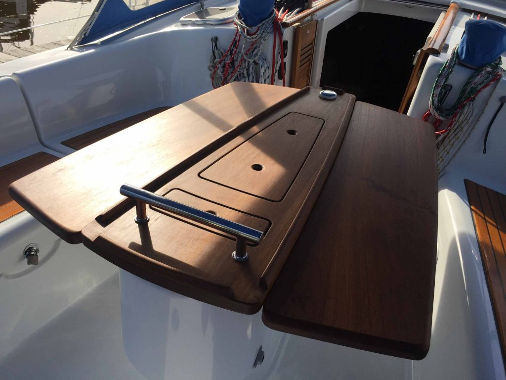 Notice how the table matches the course of the aft deck.
