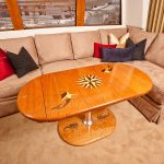 Yacht dining table with carved teak inlaid designs