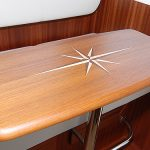 Pilothouse teak table with carved inlay