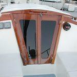 Hand-varnished teak companionway doors