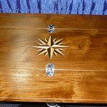 Folding teak dining table for sailboat cabin