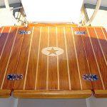 Carved teak cockpit table for sailboat binacle