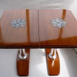 Yacht dining table with granite inlays