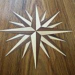 Inlaid teak compass rose design