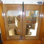 Interior view of teak companionway doors and latches