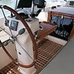 Sailboat with custom teak doors, grates, and table