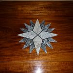 Granite star inlay for teak boat table