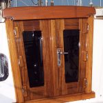 Teak companionway doors with stainless steel latch