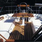 Sailboat cockpit with teak table and floorboards