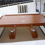 Folded boat dining table with inlaid designs
