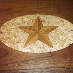 Teak inlaid design of star for boat table