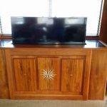 Teak entertainment center housing for yacht cabin